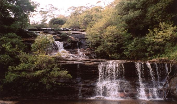 Beautiful Waterfall & Blue Mountain Image